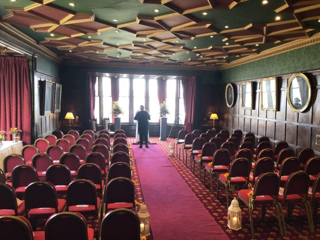 The function room at Bunchrew House Hotel set up for the wedding ceremony before room turnarounds began.