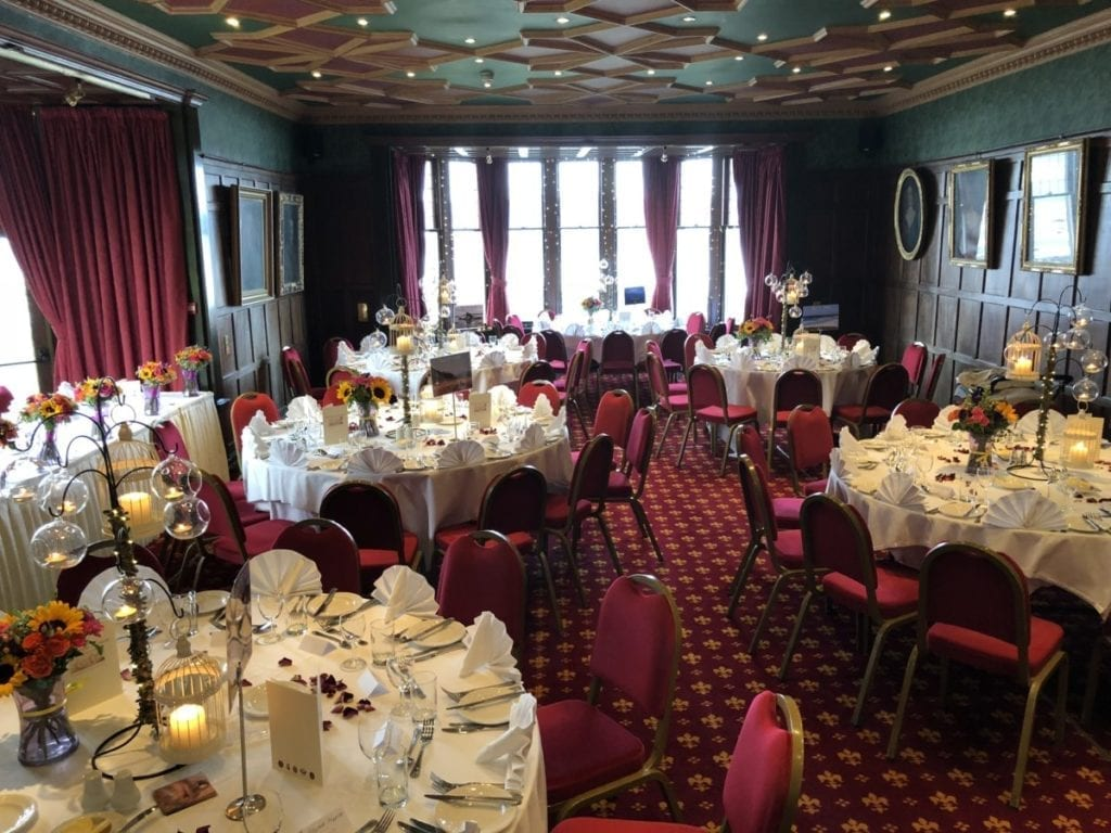 Bunchrew House Hotel's function room after the first of two room turnarounds set up for the wedding breakfast.