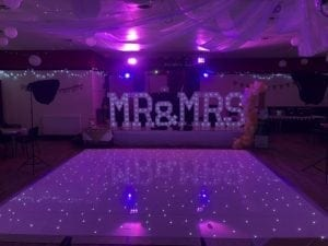 16 by 16 ft white LED dance floor with Mr and Mrs giant letters and my Gold disco.