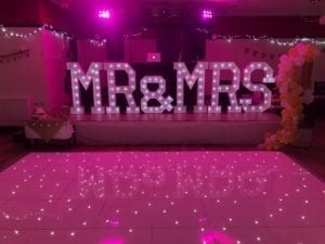 White LED dance floor. Giant letters