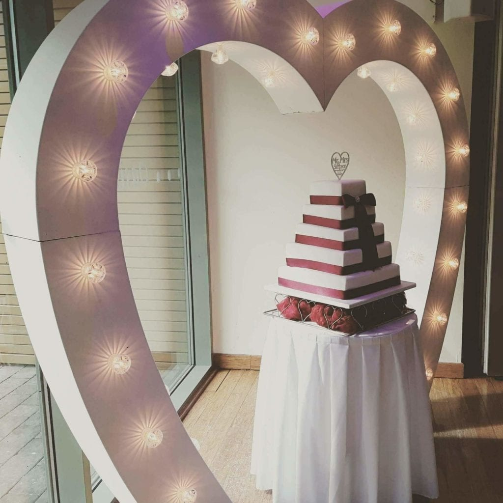 love heat arch. Perfect for your wedding ceremony or for showcasing your wedding cake and makes a great backdrop as you cut your cake.
