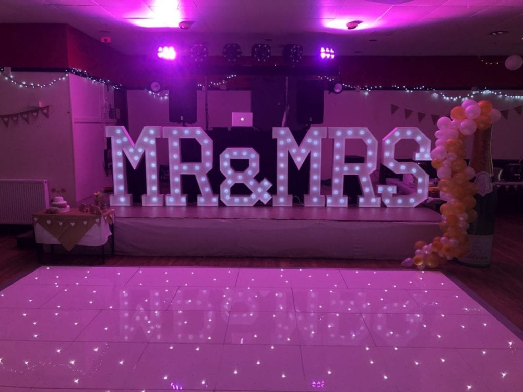Mr and Mrs letters and white Led dance floor. Wedding Party Dj
