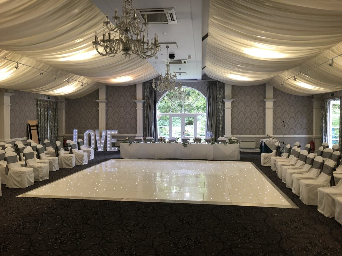 White Led dance floor hire and Love letters. Dance floor hire.