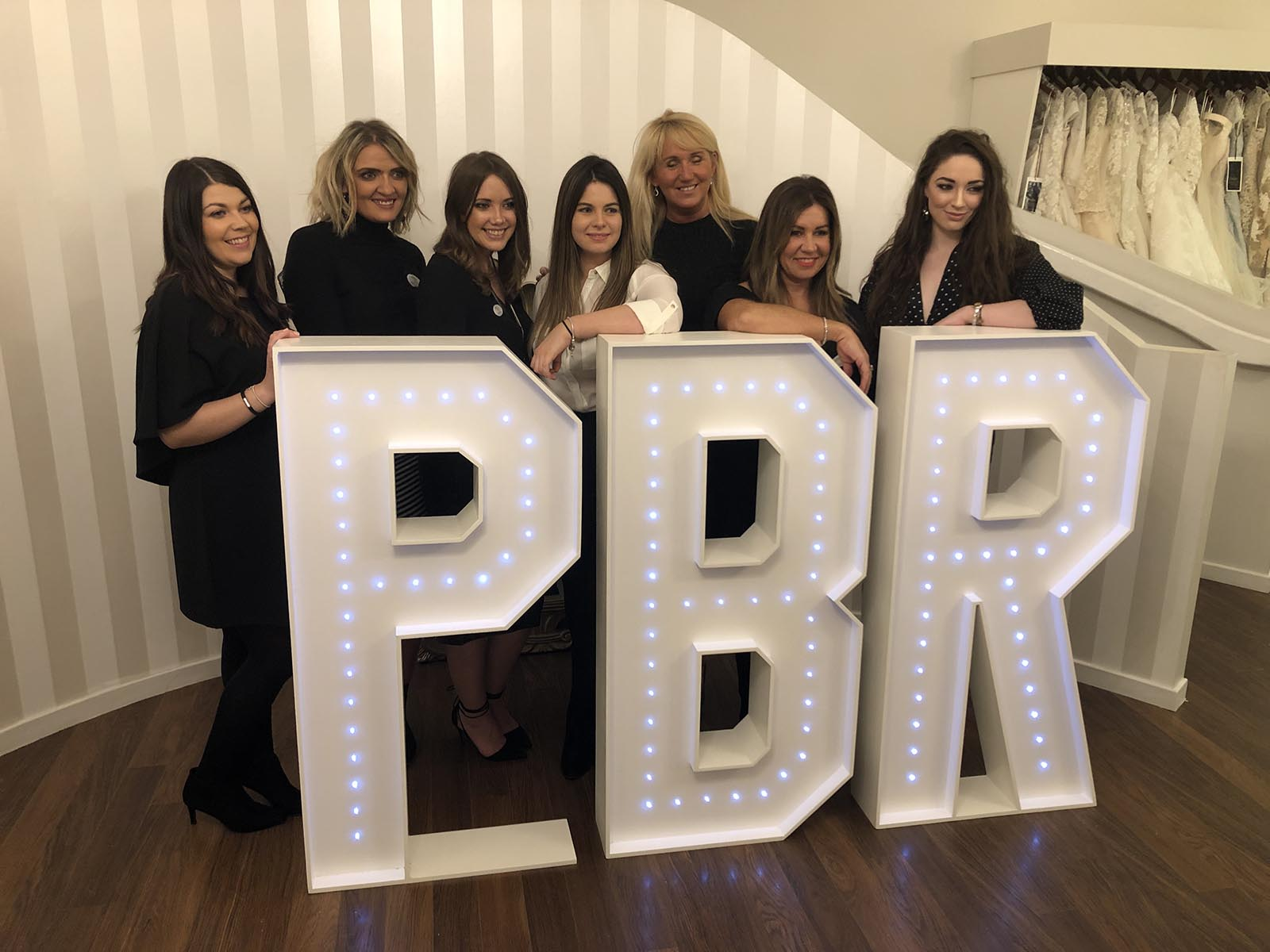 The models and staff at PBR. Giant letter hire.