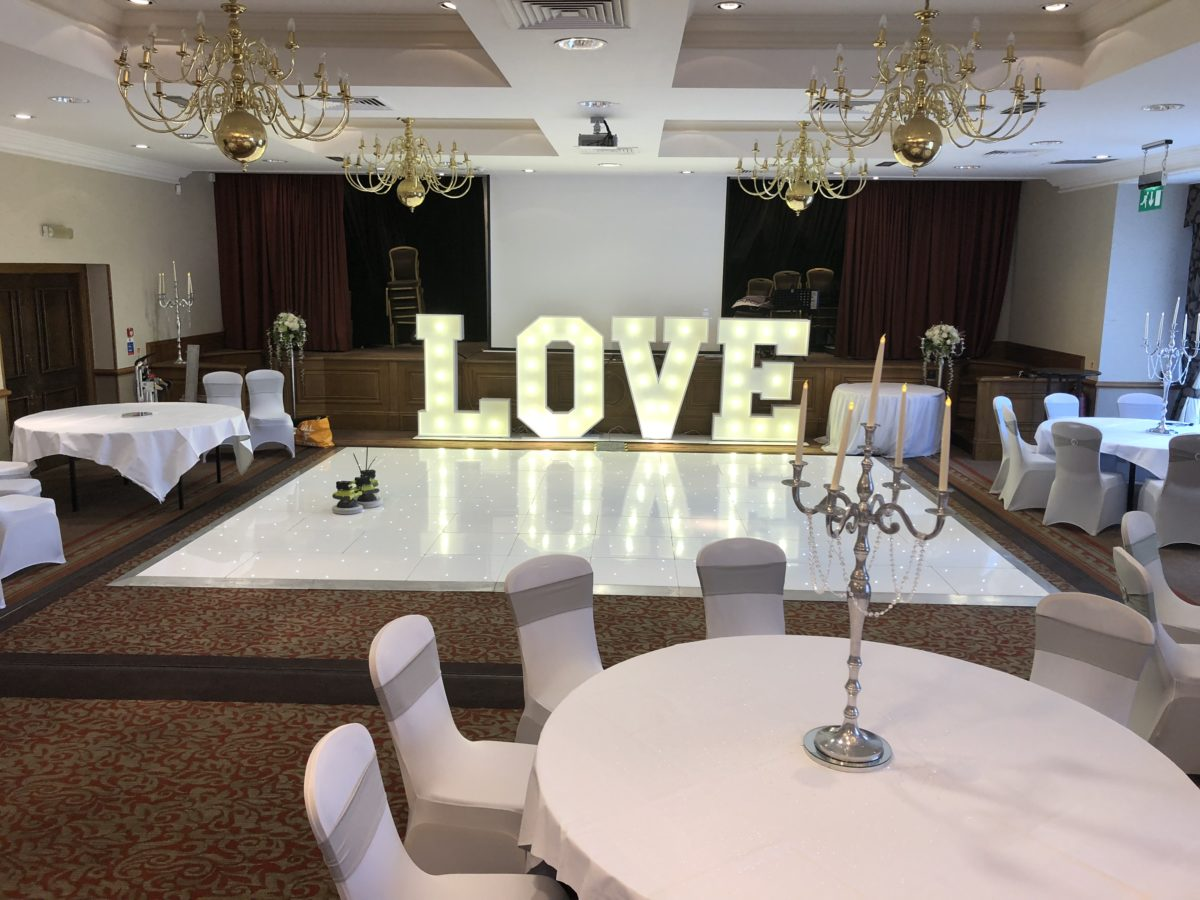 Dance floor and giant letter hire in the ballroom at Norton House Hotel.