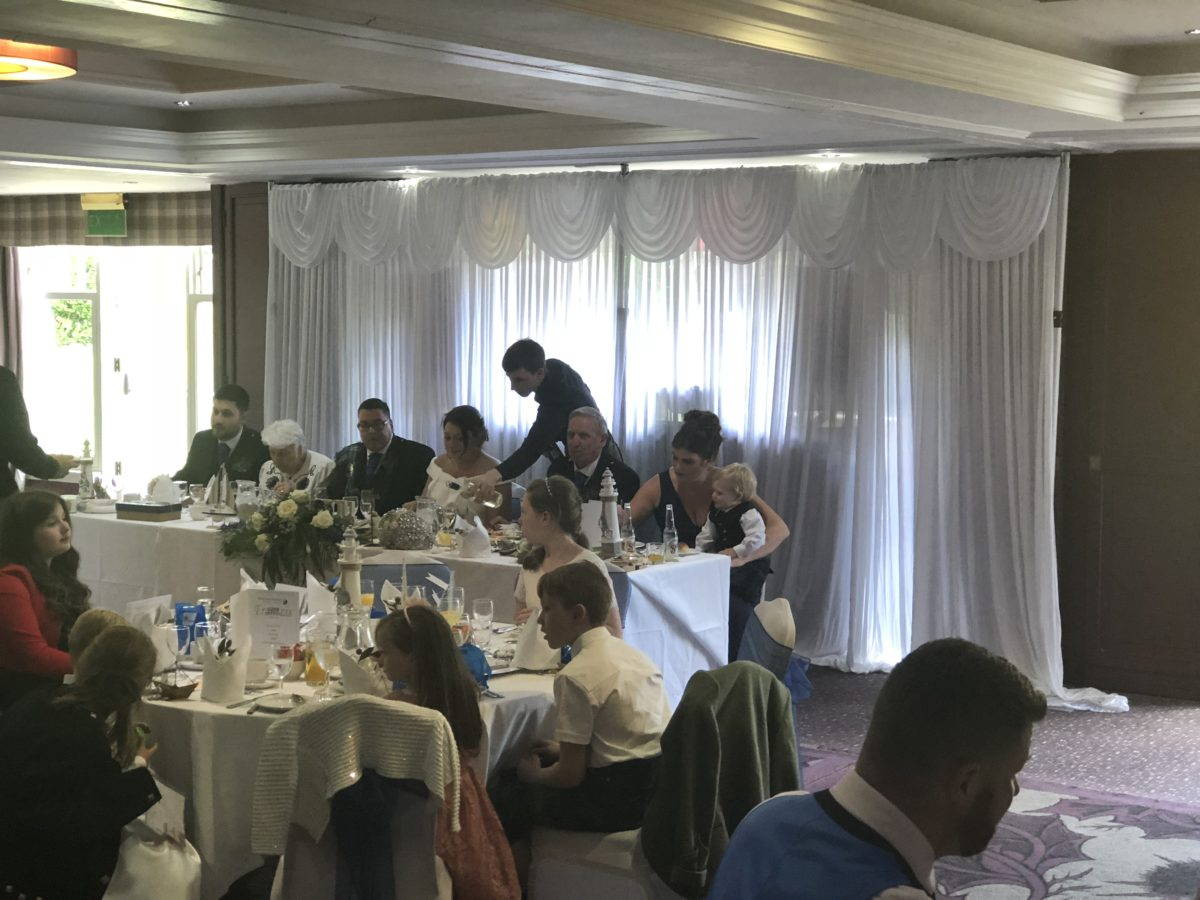 A white backdrop at Theo's wedding at Huntigtower Hotel Perth.