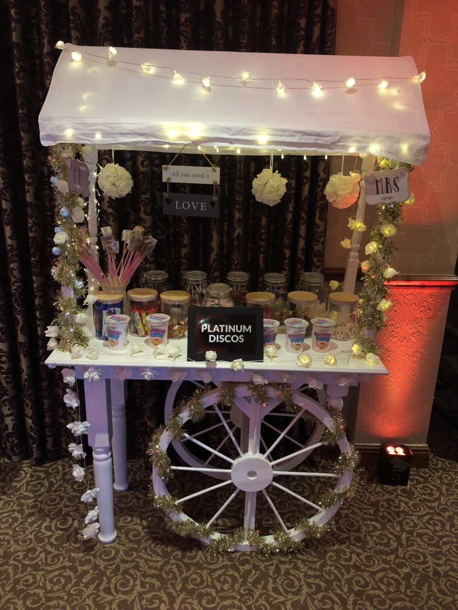 Candy cart decorated with lights and flowers. This is part of the Full Monty Deal which includes up to 7 giant letters or numbers. Part of our wedding decor range. A great addition to a mobile disco hire.