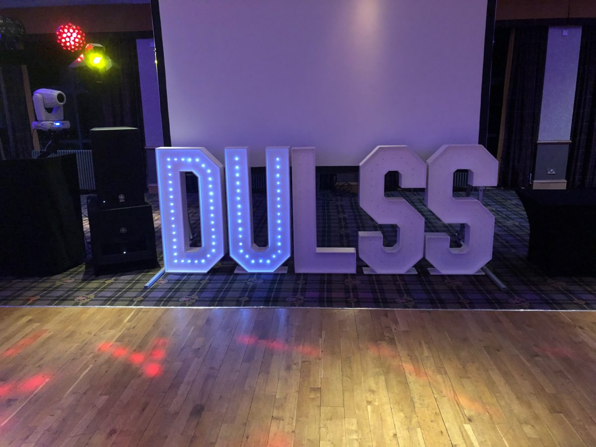 Giant letter hire for Dundee University students at The Macdonald Hotel in Aviemore, Scotland.